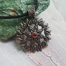 Алатырь звезда с красным камнем.
